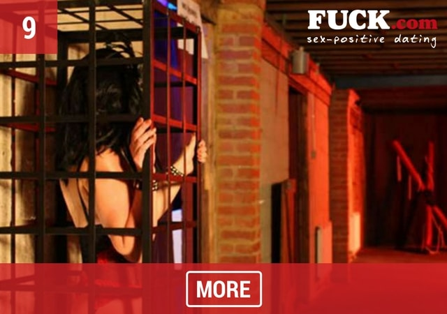 Image of woman standing in a cage at Abfab Erotic Encounters, London