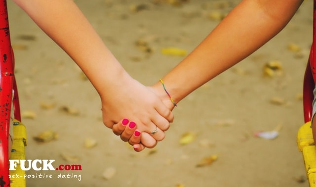 Two teenagers holding hands. Fuck.com