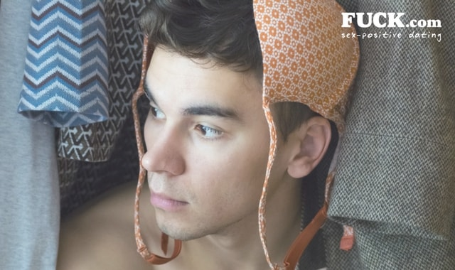 Young man in women's closet with a bra on his head. Fuck.com