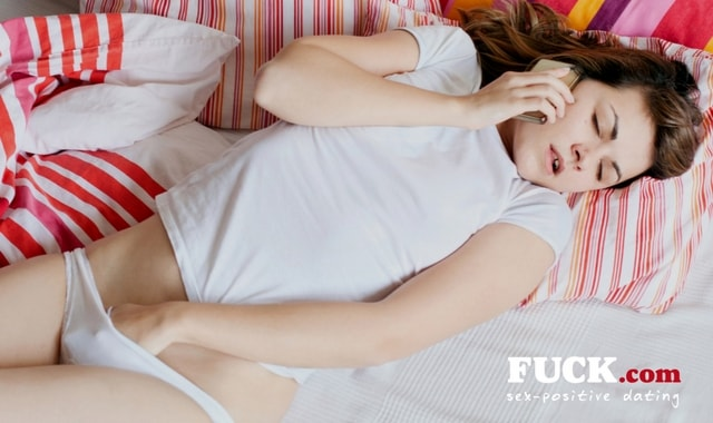 Woman having phone sex, touching herself. Fuck.com